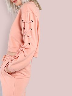Shop Cropped Lace Up Eyelet Shoulder Sweatshirt PINK online. SheIn offers Cropped Lace Up Eyelet Shoulder Sweatshirt PINK & more to fit your fashionable needs.