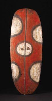 Oceanic: , Mendi Valley (Papua-New Guinea). War Shield (Wörrumbi).Wood, pigment, vine. Height: 54 ½ inches Width: 21 inches. ...
