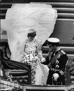 Prince Charles escorts his bride to their carriage on their wedding day, July 29, 1981.
