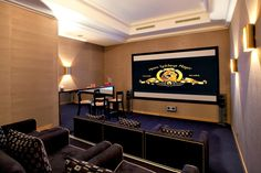 The Cinema Room features a drop-down screen, dark timber bar and bespoke leather seating, designed by Taylor Howes