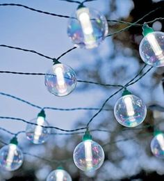 Our Solar-Powered Globe String Lights add sparkle to your outdoor areas. Each of the 25 clear glass bulbs holds a bright LED light. The energy-efficient solar panel sets up anywhere to illuminate the lights for up to 8 hours on an charge. Lantern String Lights, String Lights Outdoor, Globe Lights, Light String, String Lighting, Eclectic Outdoor Lighting, Patio Lighting, Lighting Ideas, Landscape Lighting