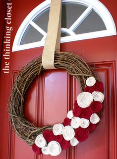 Felt Flower Wreath: Learn how to create these easy rolled rosettes that will fall-i-fy any front door wreath. Turns out they also make great hair accessories, too!  Step by step tutorial via thinkingcloset.com