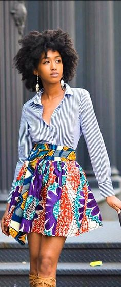 The African Print Skirt- The Noho Mini. The Noho skirt is a voluminous short skirt patterned in bold beautiful purple,teal, toffee, orange and speckled cream hues. The Noho Mini skirt is fully gathered and sits comfortably at the waist and boasts hidden side seam pockets. African fashion, Ankara, kitenge, African women dresses, African prints, African men's fashion, Nigerian style, Ghanaian fashion, fashion blogger (affiliate)