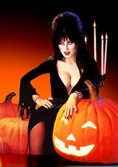 """~Elvira ~ Vintage - In 1981, Cassandra Peterson, born Sept. 18, 1951, became a weekend TV Vampira horror-host of 'Elvira's Movie Macabe'. She was a quick-witted, Valley-girl-type character named Elvira, Mistress of the Dark. With heavily applied pancake-horror make-up & a towering black beehive wig to conceal her flame-red hair, Elvira wore a tight-fitting, low-cut black gown which showed ample cleavage. At the closing of each show, Elvira wished her audience """"Unpleasant dreams""""!"""