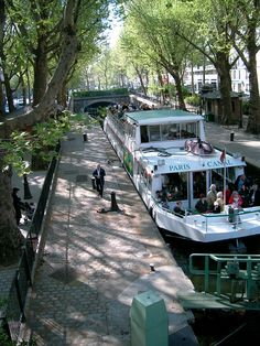 The Canal Saint-Martin, Paris. Today the canal is lined with little cafés and art galleries, the perfect place to take some time out from the busier tourist spots. You can take a ride on one of the Tour boats. You can find a nice spot for people watching. Paris Travel, France Travel, Paris France, Paris Paris, Paris City, Paris Canal, Monuments, Image Paris, Canal Saint Martin
