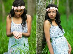 A Plano senior portrait picture of high school student holding a caterpillar in her palms out in the woods wearing a flower head band in baby blue dress taken by Chantal Brown Photography.