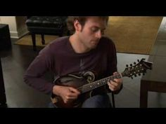 Chris Thile departs from his bluegrass ways to play Bach's E Major Prelude, Partita 3, on his really nice mandolin.