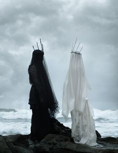 American Ghoul, Siren, two spectral figures standing on the shore
