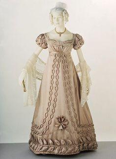 Ball Gown circa 1820-1823. Possibly French or English. Silk satin, trimmed w/ silk satin & silk bobbin lace. Via V