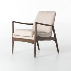 "Dramatic arms and a deeper seat offer relaxation with mid-century modern sophistication. The sculpted frame of the Braden Chair adds an architectural feel to a light camel colored upholstery. 27""W x 30.75""D x 32.25""H"