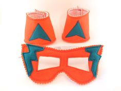 Check out this item in my Etsy shop https://www.etsy.com/uk/listing/225358261/orange-with-turquoise-superhero-mask-and