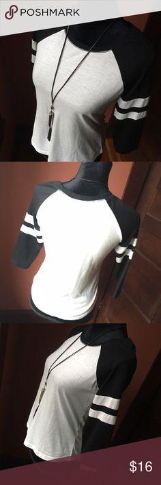 Black & White Varsity Tee Vintage style soft cotton black and white raglan varsity tee with 3/4 sleeves. Size S Tops Tees - Short Sleeve