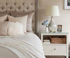 bedrooms - pale mauve walls gray linen tufted headboard gray duvet pink mauve pillows metallic pink pillow white shag pillow white wool rug white nightstand silver lamp