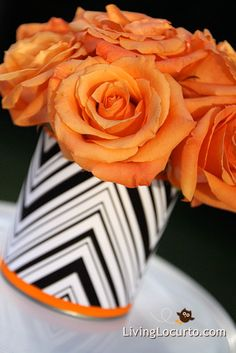 Black, White & Orange centerpiece flowers.  Just wrap a coffee can with black/white scrap paper and ribbon.