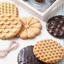 Decorative peanut butter cookies with a dark chocolate glaze.