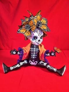 "This Day of the Dead doll is a one-of-a-kind doll made from a Monster High ""Travel Scaris"" Skelita Calaveritas base. She wears a flowery ..."