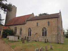 All Saints, Kirby Cane. As one approaches this church one sees that the walls are covered with render rather than the bare flints we are more accustomed to today. Around the base of the tower are short pilasters about eight inches wide, like narrow buttresses, presumably to give support. The entrance to the church is through a fine Norman south door which has an animal's head at it's apex. The font is 14th century and is crisply carved with male and female heads and shields.