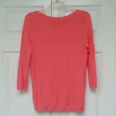 Sweater 3/4 sleeves Pinky salmon color sweater, light weight material, very cute over a tank top or by itself, the tag has been cut off, but this is a size M Sweaters