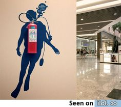 Instead of storing our fire extinguisher on the hot water heater out of sight and out of mind...this would be so cute!