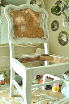 Modernizing an old cane-back chair with tufting - the before is gorgeous!