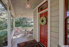 Exterior House Colors: beige, white and red. Love how the front door grabs your attention. Wish I had the nerve to paint my front door this color!