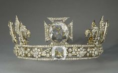 Queen Mary's Crown made by Garrard & Co, used to contain the Koh-i-Noor diamond as well as the Cullinan III and the Cullinan IV. However, in 1914 these diamonds were replaced by crystal models. It contains approximately 2,200 diamonds and was specially constructed so that the arches could be removed, as seen here.