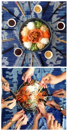 Tossing 'yee sang/yu sheng' (Chinese New Year salad). Essentially, the higher you toss, the more luck you get!