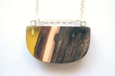 Modern curved pendant from yellow resin and vibrant by BoldB, $49.00