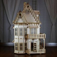 Victorian Dollhouse - Gothic Victorian Doll House Kit, $97.99 (http://woodvictoriandollhouse.com/gothic-victorian-doll-house-kit/)