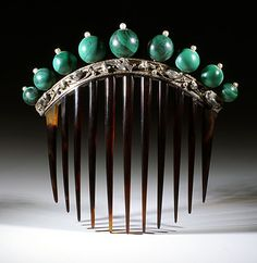 Second French Empire tortoiseshell comb from the Eugenie period. A silver gallery has green malachite balls on top.