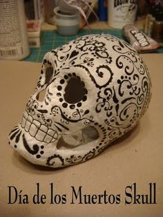 A common symbol of the Day of the Dead or Dia de  Los Muertes holiday is the skull (in Spanish calavera), which celebrants represent in masks, called calacas.