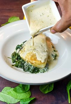 Foil Baked Chilean Sea Bass with Lemon Parmesan Cream SauceBaking this delicious dish sealed in foil along with garlic cream spinach adds additional flavor while it steams the fish to perfection. The lemon sauce blended with Parmesan cheese and whipp Fish Dinner, Seafood Dinner, Fish And Seafood, Seafood Recipes, Cooking Recipes, Healthy Recipes, Halibut Recipes, Cooking Games, Swordfish Recipes