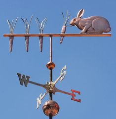Rabbit Pulling Carrots Weathervane - Handcrafted Of Copper - The Rabbit Weather Vane Pulling Carrots is one of our earliest weathervane designs.