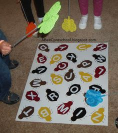 "Try to put colored bugs Insects and Spiders: We played ""Swat"". This is one of our favorite games. Try to be the first to swat the letter as it is called. A, Bee, C, Preschool Bug Activities, Alphabet Activities, Classroom Activities, Movement Activities, Alphabet Crafts, Preschool Bug Theme, Preschool Literacy, April Preschool, Kindergarten"