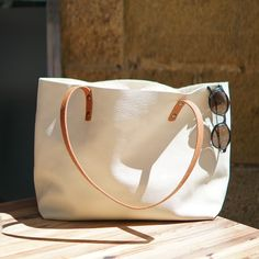 ToteBag by CALMA Project This leather bag is very durable and especially resistant to the use and the passage of time. We only use Full Grain Leather, which feels very soft and silky. You can use your bag everyday and it will retain its shape and texture for a long long time! 