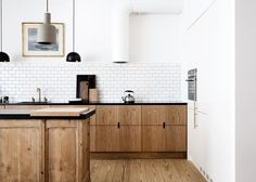wood-cabinets-kitchen-subway-tile-notched-pulls.jpg