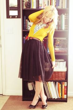 yellow sweater and black skirt. This would be cute in navy and yellow too. I'm a huge fan of swingy skirts!