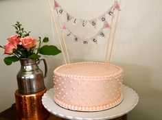 Burlap/Canvas Bunting Banner Wedding Cake Topper with Personalized Couple's Names. $16.00, via Etsy.