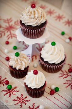 Christmas cupcakes topped with red and green Sixlets by Bakingdom