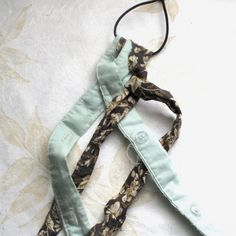 easy peasy and much better if you sew the ends instead of using glue.  fabric scrap, project, diy, headband, tutorial, make your own