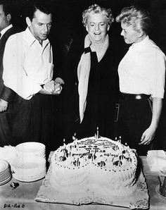 Frank Sinatra and Doris Day help Ethel Barrymore celebrate her birthday on the set of Young at Heart