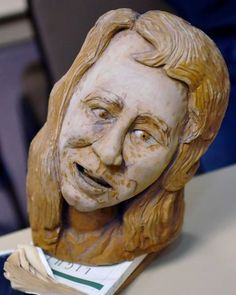 This finished bust is of his wife, also mounted on a book first, then a wooden base. Herman Davis, left, a local woodcarver and story teller, was at the Beaumont Public Library Downtown branch this week, demonstrating his art of carving all types of wood, and telling his folk stories during a program for adults. He brought with him several large examples of carving that he has finished as well as continues to carve on.   Dave Ryan/The Enterprise