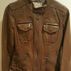 Michael Kors Leather Jacket In good condition, clearing out closet. :) will negotiate price. I bought this a few years ago, it no longer fits me. I worn it a few times. Michael Kors Jackets & Coats