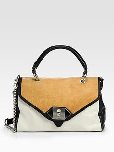 "this is as much into the ""color block"" trend as I might be willing to go.  This would be a lovely bag for this summer"