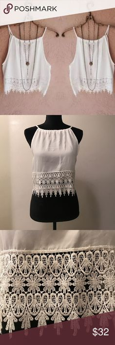 SALE White BoHo Lace Tank Top Medium NWOT One white lace BoHo tank top by Amy Fashion. It is women's size medium. This item is a brand new boutique piece but please be aware it did not come with any tags. It is in mint condition and has never been worn. It's straps are adjustable. This is a very sexy and comfortable top! Amy Fashion Tops Tank Tops