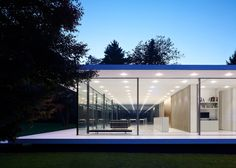 Completed by Stuttgart architects Werner Sobek Design, the ground floor of House D10 is raised just above the surrounding lawn, while a basement floor is concealed beneath.