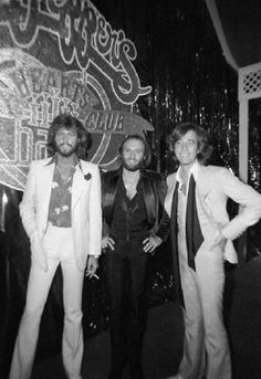 """New York: Collectively known as the BEe Gees' brothers Barry, Maurice, and Robin Gibb gather inder sign heralding their new movie during party at Roseland The new film, """"Sgt. Pepper's Lonely Hearts Club Band,"""" had its premier at Radio City Music Hall. Pop Rock Bands, Cool Bands, Sgt Pepper Movie, Robin Pictures, Family Pictures, Barry Gibb, Radio City Music Hall, Band Of Brothers, Lonely Heart"""