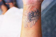 Dartboard Tattoo with wings ...