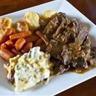 Amazing Pot Roast!!! (makes its on gravy)          2 (10.75 ounce) cans condensed cream of mushroom soup,   1 (1 ounce) package dry onion soup mix,  5 1/2 pounds pot roast ( I usually use a med to large size london broil) 1 1/4 cups water (I use less to make a thicker gravy 1/2c.)