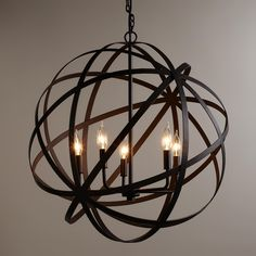 $249.99  world market     Crafted by Indian artisans in a unique industrial style, our exclusive five-bulb chandelier features an open, geometric design finished in aged black. This large, globe-like chandelier has a timeless appeal that's perfect for any room in the home.